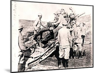 Loading shell into 155 mm gun, c1914-c1918-Unknown-Mounted Photographic Print