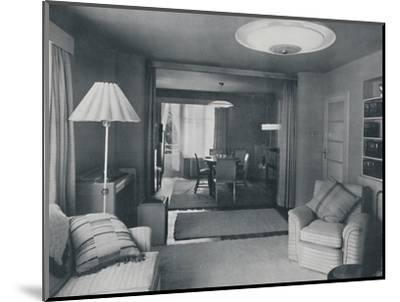 'Dining and living room, divided only by heavy curtains in an attractive modern weave', 1942-Unknown-Mounted Photographic Print
