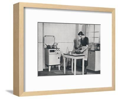 'A British kitchen equipped with a cabinet gas cooker', 1942-Unknown-Framed Photographic Print