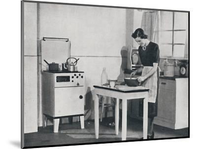 'A British kitchen equipped with a cabinet gas cooker', 1942-Unknown-Mounted Photographic Print