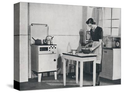 'A British kitchen equipped with a cabinet gas cooker', 1942-Unknown-Stretched Canvas Print