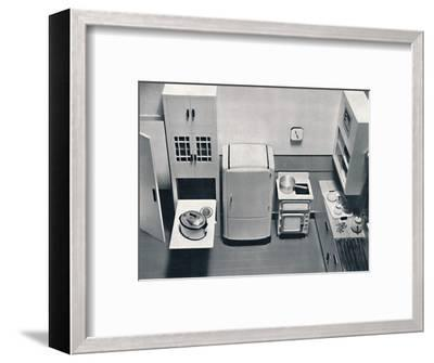 'View of a kitchen, designed by H.M.V. Household Appliances', 1938-Unknown-Framed Photographic Print