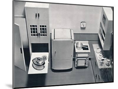 'View of a kitchen, designed by H.M.V. Household Appliances', 1938-Unknown-Mounted Photographic Print