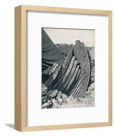 'The Oseberg ship in the mound, showing the carving on stem and railing', 1935-Unknown-Framed Photographic Print