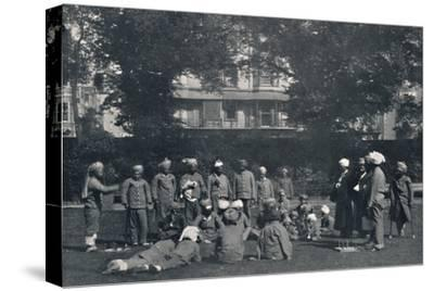 'Convalescent Indian Soldiers Playing Quoits on the Eastern Lawns', c1915, (1939)-Unknown-Stretched Canvas Print