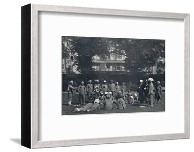 'Convalescent Indian Soldiers Playing Quoits on the Eastern Lawns', c1915, (1939)-Unknown-Framed Photographic Print