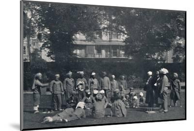 'Convalescent Indian Soldiers Playing Quoits on the Eastern Lawns', c1915, (1939)-Unknown-Mounted Photographic Print