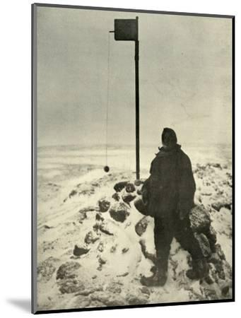 'Professor David Standing By Mawson's Anemometer', c1908, (1909)-Unknown-Mounted Photographic Print