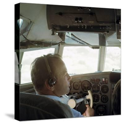 Piloting an Illyusin 18 Airliner-Unknown-Stretched Canvas Print