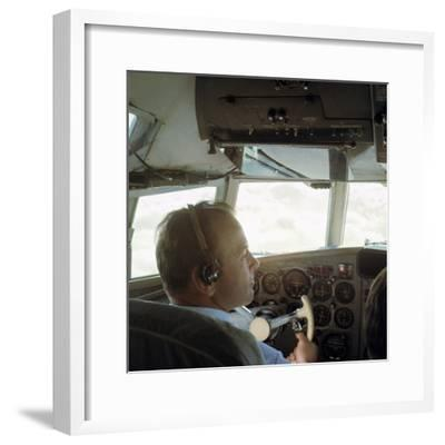 Piloting an Illyusin 18 Airliner-Unknown-Framed Photographic Print