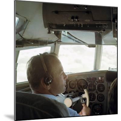 Piloting an Illyusin 18 Airliner-Unknown-Mounted Photographic Print