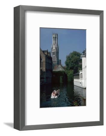 Canal, old houses, and the Belfrey of the Tour Des Halles in Bruges-Unknown-Framed Photographic Print