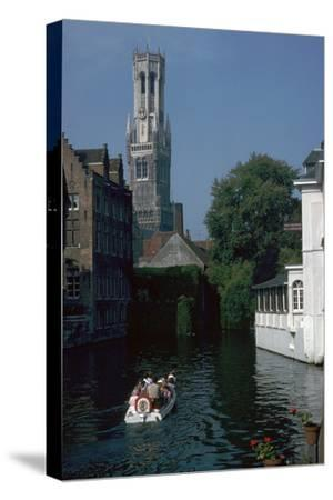 Canal, old houses, and the Belfrey of the Tour Des Halles in Bruges-Unknown-Stretched Canvas Print