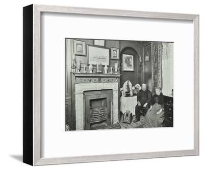 Elderly couple in Victorian interior, Albury Street, Deptford, London, 1911-Unknown-Framed Photographic Print