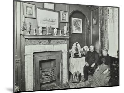 Elderly couple in Victorian interior, Albury Street, Deptford, London, 1911-Unknown-Mounted Photographic Print