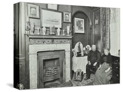 Elderly couple in Victorian interior, Albury Street, Deptford, London, 1911-Unknown-Stretched Canvas Print