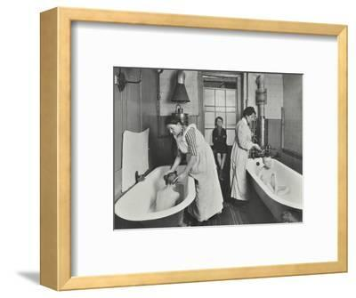 Attendants bathing boys at the Central Street Cleansing Station, London, 1914-Unknown-Framed Photographic Print