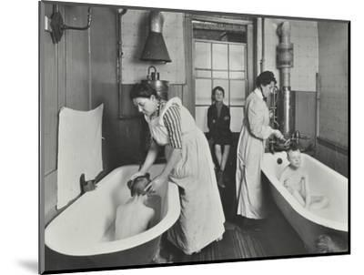Attendants bathing boys at the Central Street Cleansing Station, London, 1914-Unknown-Mounted Photographic Print