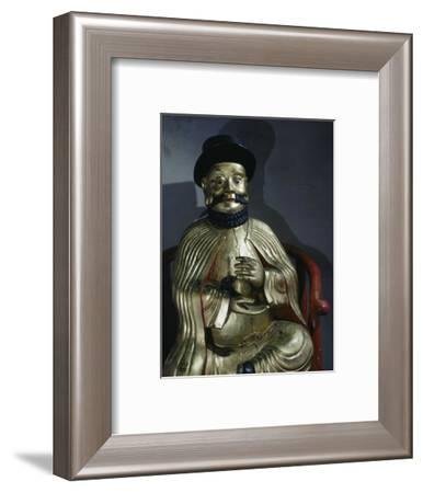 Gilt statue of Marco Polo holding a pomegranate, symbol of wealth and prosperity-Werner Forman-Framed Photographic Print