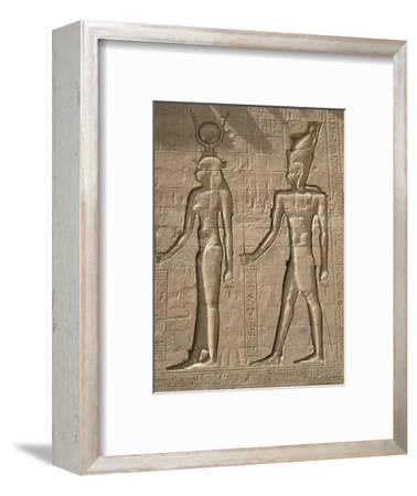 Reliefs on the outer back wall of the temple complex of Edfu, Egypt-Werner Forman-Framed Photographic Print
