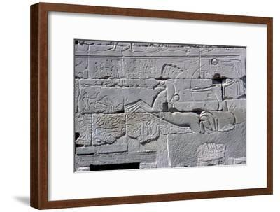 Detail of relief of Pharaoh in chariot riding down his enemies, Temple of Amun, Karnak, c1400 BC-Unknown-Framed Giclee Print