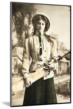 Postcard of a woman golfer, c1912-Unknown-Mounted Photographic Print