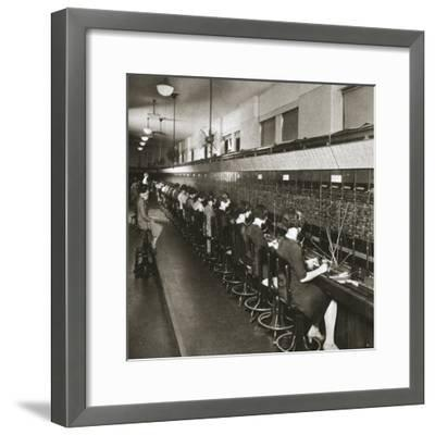 Inside a New York telephone exchange, USA, early 1930s-Unknown-Framed Photographic Print