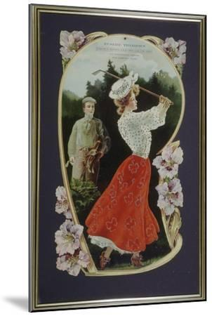 Lady golfer playing a shot, watched by her caddy, c1910-Unknown-Mounted Giclee Print