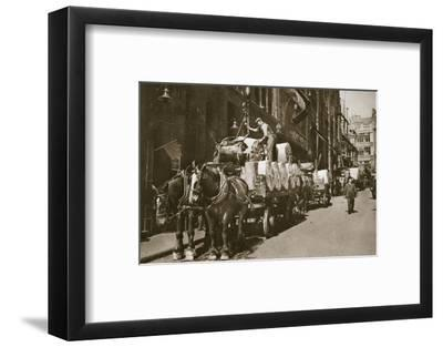 Hoisting the paper into a newspaper office, 20th century-Unknown-Framed Photographic Print