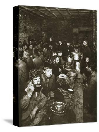 Russian manual labourers eating a meal, late 19th century-Unknown-Stretched Canvas Print