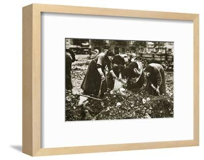 The poor of Berlin rummaging in refuse heaps, Germany, c1914-c1918-Unknown-Framed Photographic Print