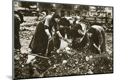 The poor of Berlin rummaging in refuse heaps, Germany, c1914-c1918-Unknown-Mounted Photographic Print