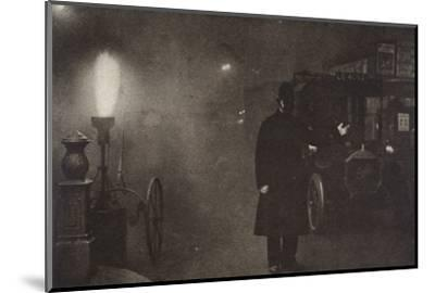 A constable directing traffic in the fog, London, c1910s-c1920s(?)-Unknown-Mounted Photographic Print