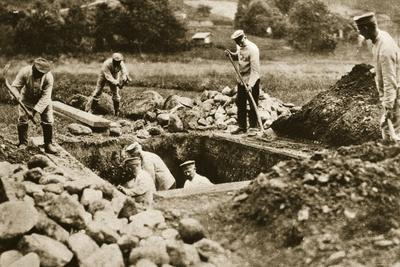 Digging mass graves behind the German lines, World War I, c1914-c1918-Unknown-Framed Photographic Print