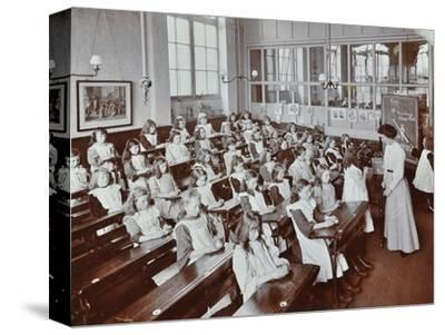 Classroom scene, Albion Street Girls School, Rotherhithe, London, 1908-Unknown-Stretched Canvas Print