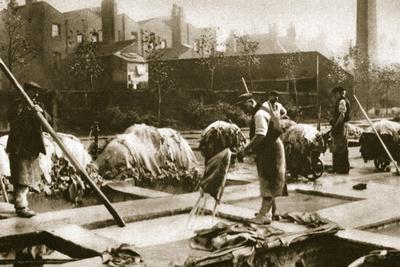 Making leather in the lime yard at Neckinger Mills, London, 20th century-Unknown-Framed Photographic Print
