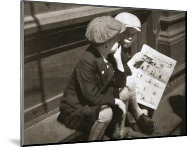 Two boys reading the comic section of the Sunday paper, New York, USA, 1931-Unknown-Mounted Photographic Print