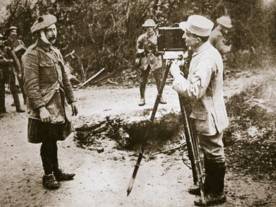 Cameraman filming a wounded soldier, Somme campaign, France, World War I, 1916-Unknown-Framed Photographic Print