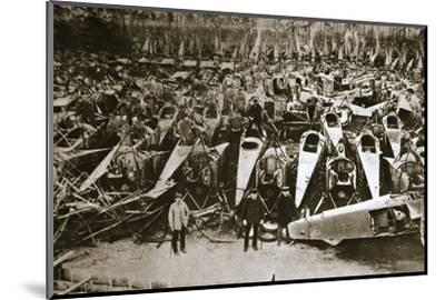 German war materiel destroyed under the terms of the Armistice, c1918-c1919(?)-Unknown-Mounted Photographic Print