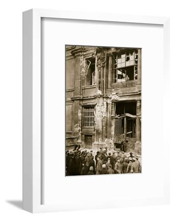A crowd of men gathered in front of a ruined building, Germany c1918-c1919(?) (1936)-Unknown-Framed Photographic Print