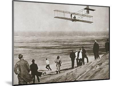 The Wright Brothers testing an early plane at Kitty Hawk, North Carolina, USA, c1903-Unknown-Mounted Photographic Print
