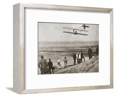 The Wright Brothers testing an early plane at Kitty Hawk, North Carolina, USA, c1903-Unknown-Framed Photographic Print