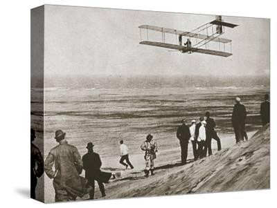 The Wright Brothers testing an early plane at Kitty Hawk, North Carolina, USA, c1903-Unknown-Stretched Canvas Print