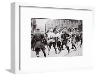 Men in Bolshevik uniform fighting police in the street, Germany, c1918-c1933(?) (1936)-Unknown-Framed Photographic Print