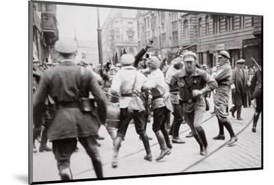 Men in Bolshevik uniform fighting police in the street, Germany, c1918-c1933(?) (1936)-Unknown-Mounted Photographic Print