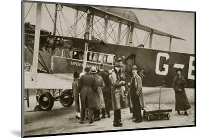 Passengers boarding an Imperial Airways aircraft for a flight to Paris, c1924-c1929 (?)-Unknown-Mounted Photographic Print
