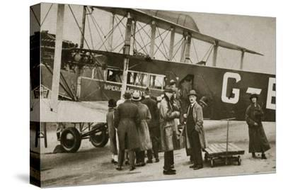 Passengers boarding an Imperial Airways aircraft for a flight to Paris, c1924-c1929 (?)-Unknown-Stretched Canvas Print