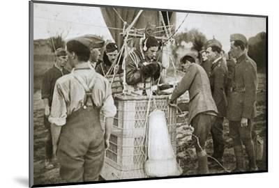 Observer of a kite-balloon testing the telephone before ascending, France, World War I,1916-Unknown-Mounted Photographic Print