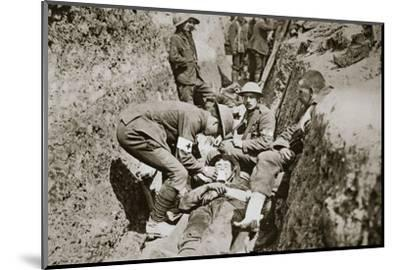 Red Cross men in the trenches tend a wounded man, Somme campaign, France, World War I, 1916-Unknown-Mounted Photographic Print