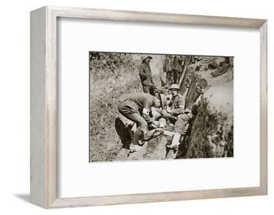 Red Cross men in the trenches tend a wounded man, Somme campaign, France, World War I, 1916-Unknown-Framed Photographic Print